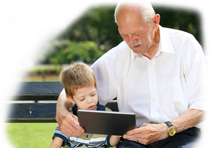 an elder man and a children wathing something on tablet a section image for Asset Protection & Business Planning